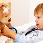 Kid-checking-his-teddy-bear-as-patient